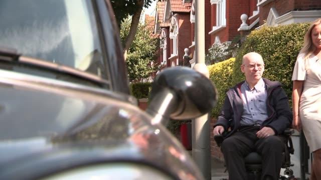 london paralympics 'failed to change attitudes towards disability'; england: ext chris stapleton interview as along street with reporter sot - stapleton stock videos & royalty-free footage