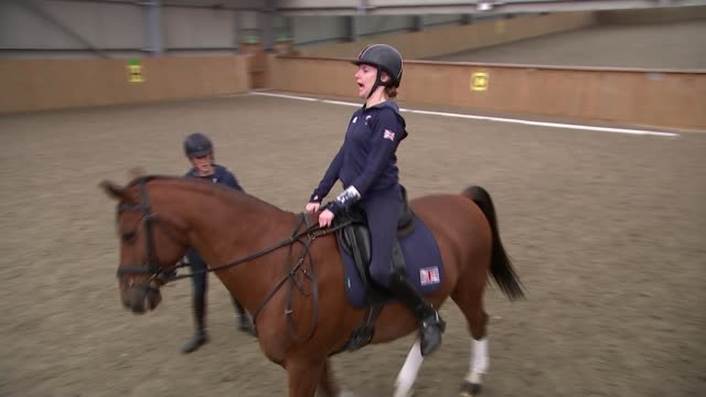 London Paralympics 'failed to change attitudes towards disability' / R14101602 Berkshire INT Sophie Christiansen riding horse in training ring