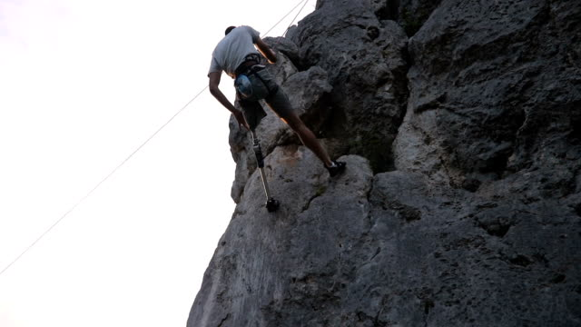 disability man climbing high - prosthetic equipment stock videos & royalty-free footage