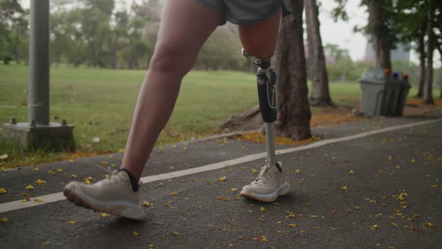 disability woman jogging with artificial limb exercising - warm up exercise stock videos & royalty-free footage
