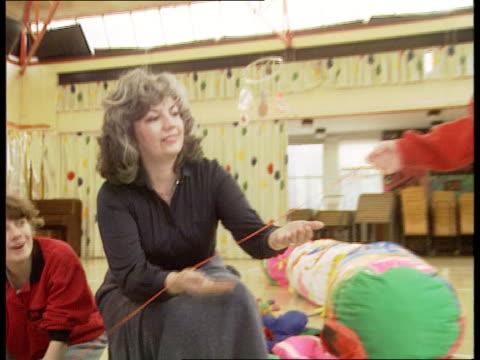 London Lewisham Watergate School MS Dr Rodica Munteanu next teachers at specialist school for handicapped CS Child doing activity TILT UP as Munteanu...