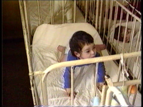 glen oglaza romania tms nurse in dorm of orphan children tcms child being fed by nurse tms baby in cot making rocking motion ms orphan children... - orphan stock videos & royalty-free footage