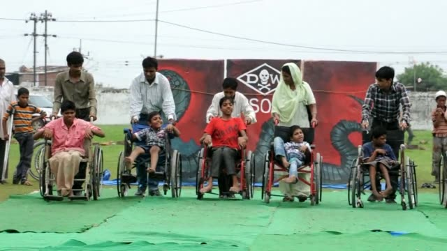 vídeos de stock e filmes b-roll de disabled children living near the site of the 1984 bhopal gas disaster many in wheelchairs others crawling staged a protest olympics thursday... - the dow chemical company