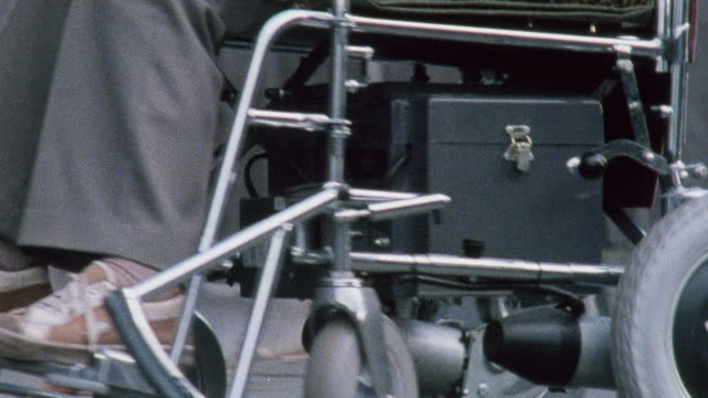 1978 montage disabled man in a wheelchair navigating a street curb / united kingdom - kerb stock videos and b-roll footage