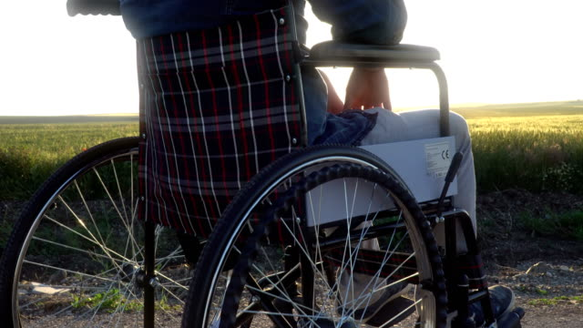 disabled man looking at the sunset - wheelchair stock videos and b-roll footage