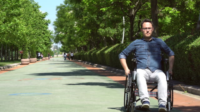 Disabled Man Rolling Away