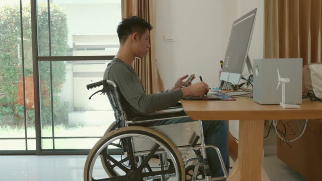disabled man sitting in a wheelchair at home - disability stock videos & royalty-free footage