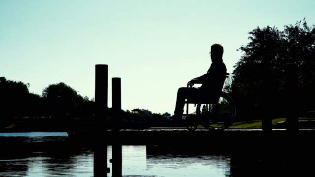 Disabled Man Standing In The Riverside