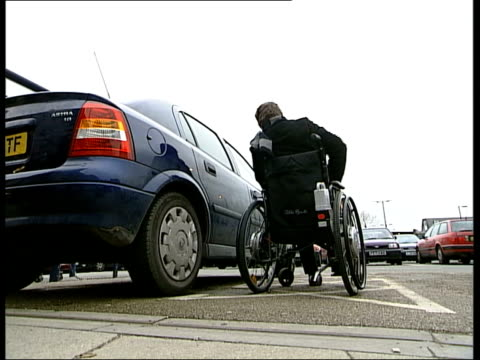 disabled parking bays used by ablebodied drivers itn sainsbury's supermarket disabled blue card in window of car cms car with man in wheelchair... - bay of water stock videos & royalty-free footage
