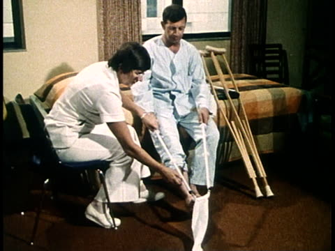 1980 MS disabled patient puts on socks using poleswith hooks/ United States