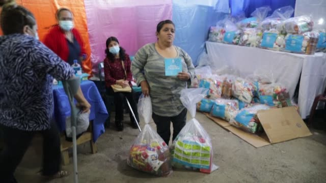 disabled people in jinotega, nicaragua, receive kits of food and hygienic products to protect themselves against covid-19 and to fight the spread of... - managua stock videos & royalty-free footage