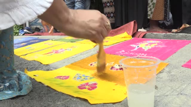 disabled people learn to make batik one of world's heritages that have been admitted by unesco on the national batik day in jakarta indonesia on... - batik stock videos and b-roll footage