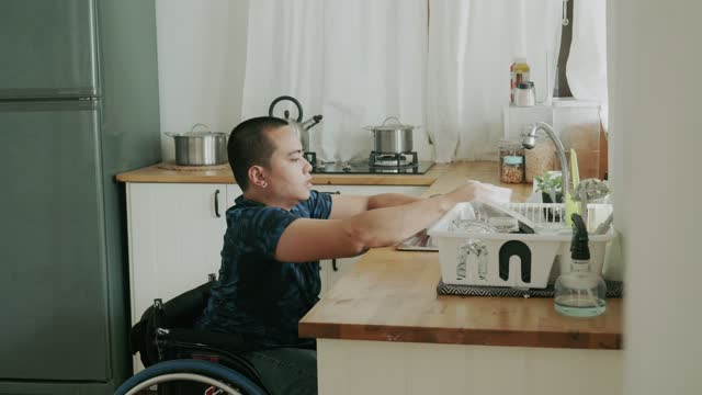 disabled person washing a cup - stock video - independence stock videos & royalty-free footage