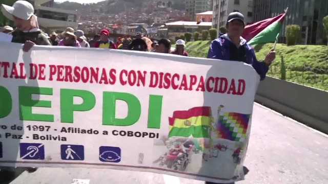 disabled persons demonstrate in la paz to demand the bolivian government to give them a 65 dollar a month pension a demand that evo moraless... - disability benefits stock videos & royalty-free footage