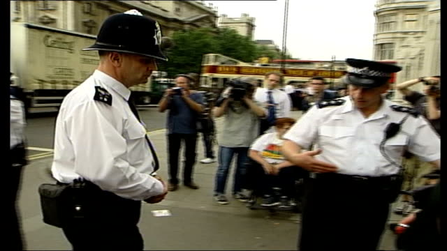 Disabled protesters removed from Houses of Parliament ITN London Houses of Parliament St Stephen's Gate Police officer telling disabled protesters...
