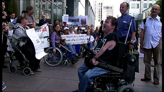 Disabled protesters stage a demonstration about Crossrail access ENGLAND London Canary Wharf EXT **Music heard SOT** Protesters singing song about...
