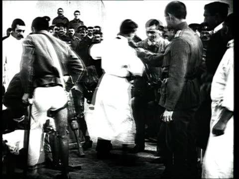 1915 montage b/w disabled soldiers trying on artifical limbs and prosthetic legs for examination/ russia - 四肢切断点の映像素材/bロール