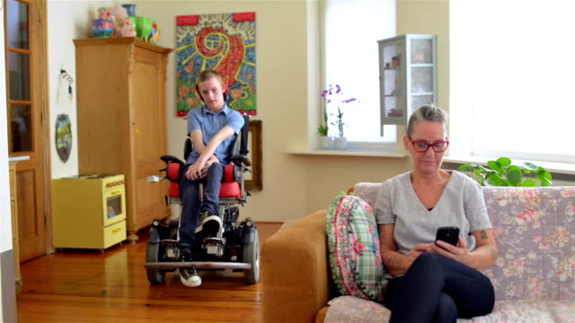 disabled son with his mother - cerebral palsy stock videos & royalty-free footage