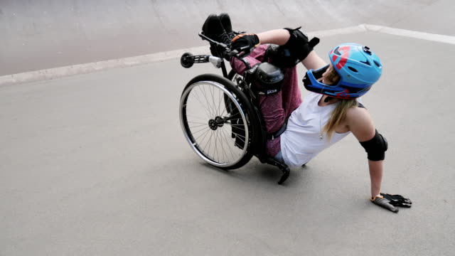 disabled woman in wheelchair doing stunts in skate park - stunt stock videos & royalty-free footage