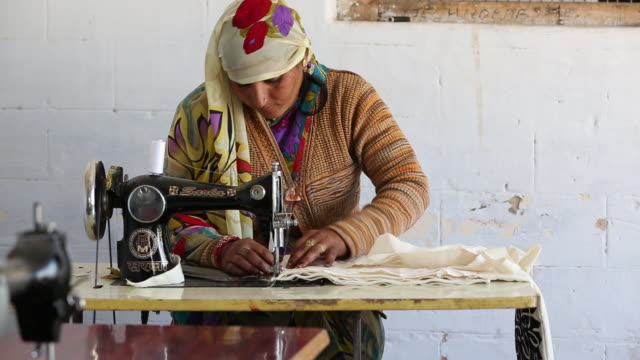 A disabled women sewing at the Barefoot College in Tilonia, Rajasthan, India.