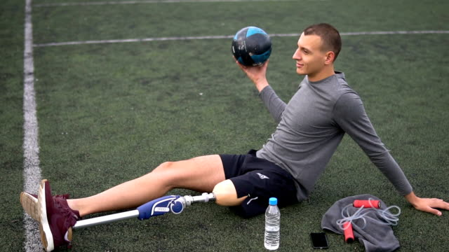 Disabled young man training outdoors
