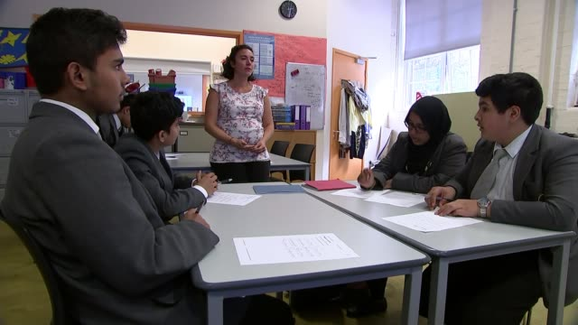 Disadvantaged children from London take part in trial of free private tutor app ENGLAND London Tower Hamlets Oaklands School INT Teacher chatting to...