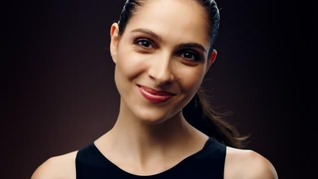 disagreeing middle eastern ethnicity woman skin care - sfondo marrone video stock e b–roll
