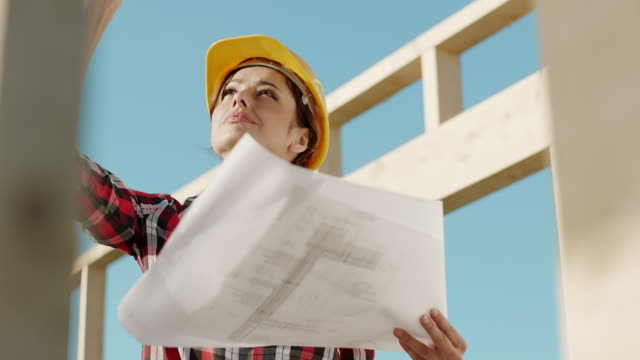 Disapointed female architect at construction site