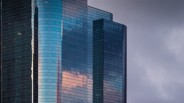 disappearing office building reflections - timelapse - dusk stock videos & royalty-free footage