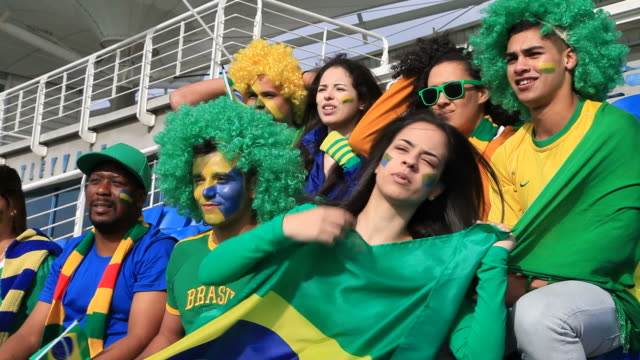 disappointed fans hoping brazil would score - hand fan stock videos and b-roll footage