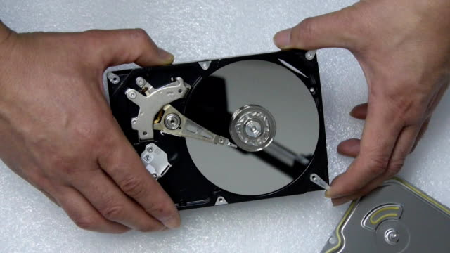 disassemble a hard disk with a screwdriver - disk stock videos and b-roll footage