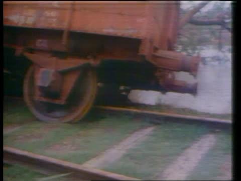 vídeos y material grabado en eventos de stock de cyclone aftermath bangladesh tms railway line with telegraph pole crashed across debris scattered in b/g ms train wagon blown off track cms wagon at... - bangladesh