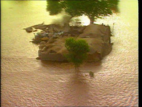floods cf tape no longer available pakistan airv flooded farmland track lr airv floodwater covers road track forward airv farmer and oxen in flooded... - waist stock videos & royalty-free footage
