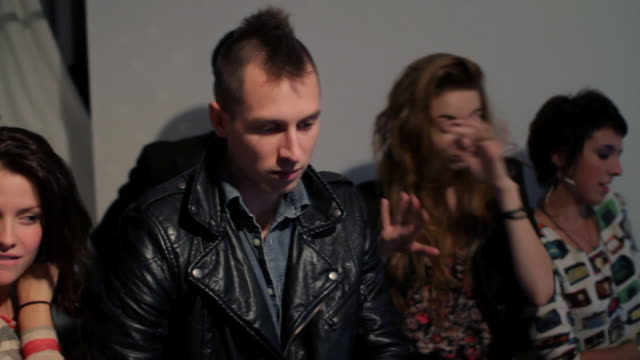stockvideo's en b-roll-footage met disc jockey playing record with group of people dancing at party - hanenkam haardracht
