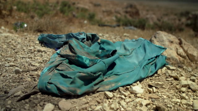 discarded clothes left behind on the sinjar mountains by yazidis fleeing islamic state extremists - sinjar stock videos & royalty-free footage