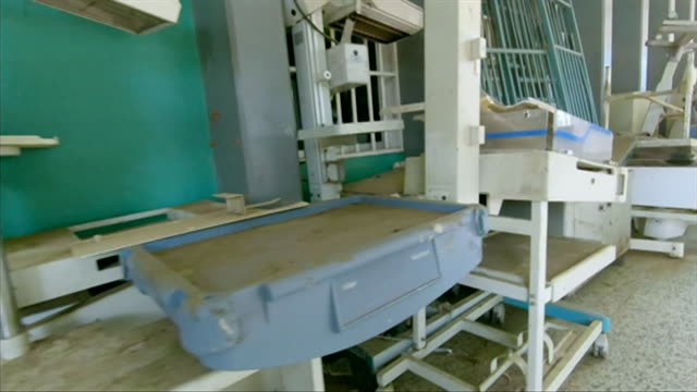 discarded hospital equipment and beds piled up at a hospital in zulia venezuela due to a lack of money to repair them - bed furniture stock videos & royalty-free footage