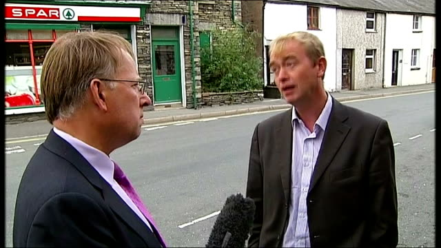 disciplinary proceedings against lord rennard dropped by liberal democrat party westmorland ext tim farron mp chatting with local resident as... - クリス・レナード点の映像素材/bロール
