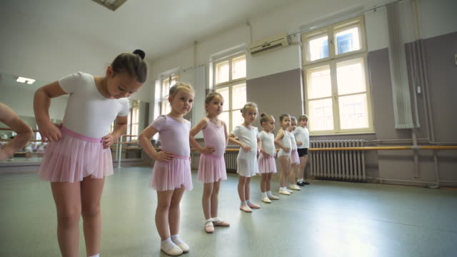 disciplined class of young ballerinas - ballet shoe stock videos & royalty-free footage