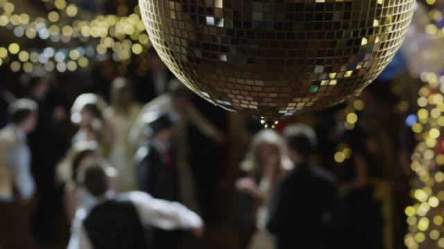 CU Disco ball glittering, people dancing in background / Cedar Hills, Utah, USA