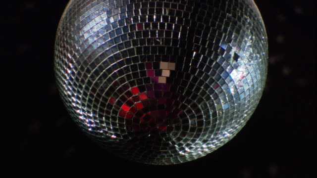 a disco ball glitters. - mirror ball stock videos & royalty-free footage