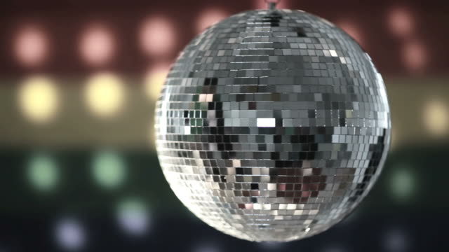 Disco ball spinning against gay pride flag