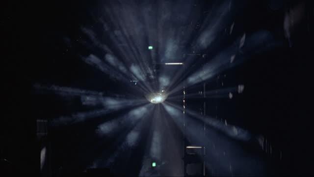 A disco ball spins in a nightclub.