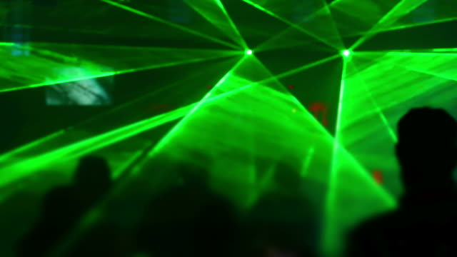 disco dancers in the laser light - techno music stock videos & royalty-free footage
