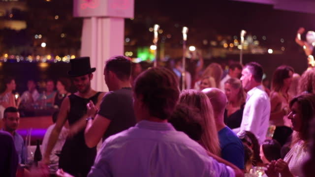 disco party ibiza with color lights and people dancing - balearic islands stock videos and b-roll footage