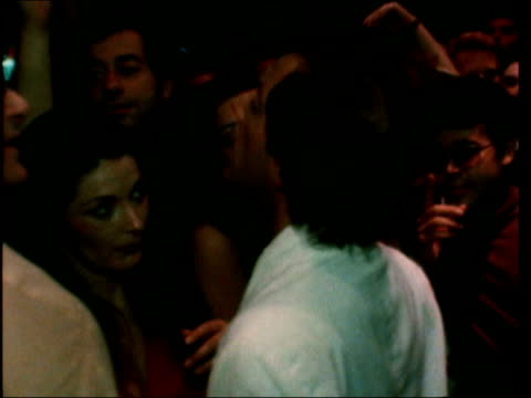 """studio 54; b) usa: new york: night cms sign """"54""""; tilt waiting crowd cms crowd and steve rubell sof: """"you're not shaved.........go home"""" girl crowd... - b rolle stock-videos und b-roll-filmmaterial"""