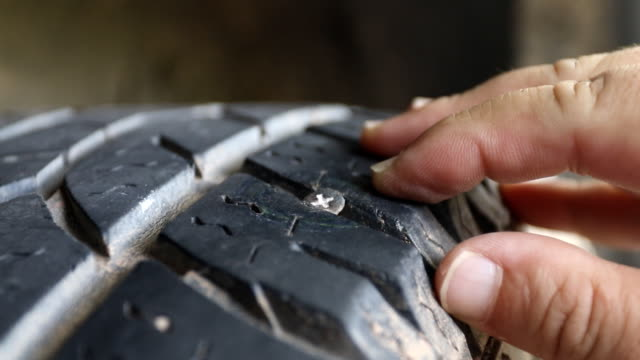 discovered the screw that caused the tyre to go flat - tyre stock videos & royalty-free footage