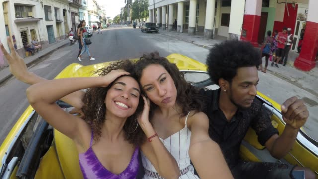 discovering colourful havana cuba young friends - cuba video stock e b–roll