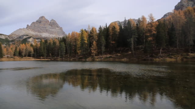 Discovering the beautiful Dolomites mountains with autumn colors.