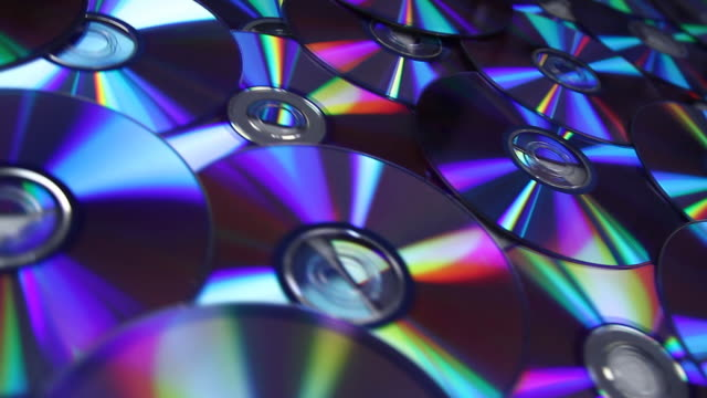 dvd discs background, hd, ntsc - cd rom stock videos & royalty-free footage