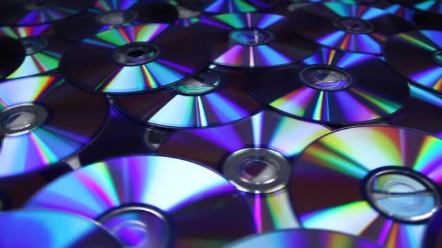 dvd-cds hintergrund, hd-qualität, ntsc - dvd stock-videos und b-roll-filmmaterial